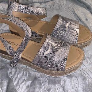Platform sandals snake print